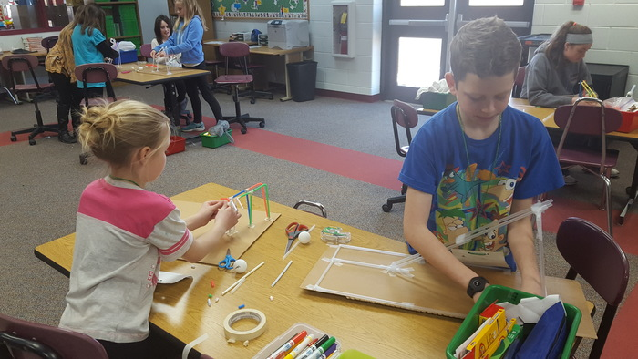 Trailside future engineers creating a roller coaster out of straws during STEAM day!